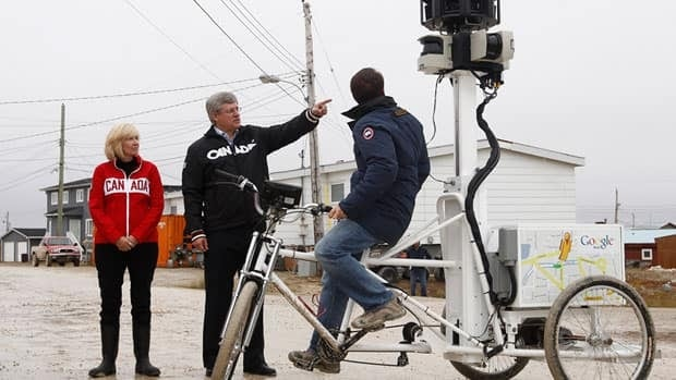 Prime Minister Stephen Harper and his wife Laureen check out the Google tricycle that will be wheeling down Cambridge Bay streets this week.