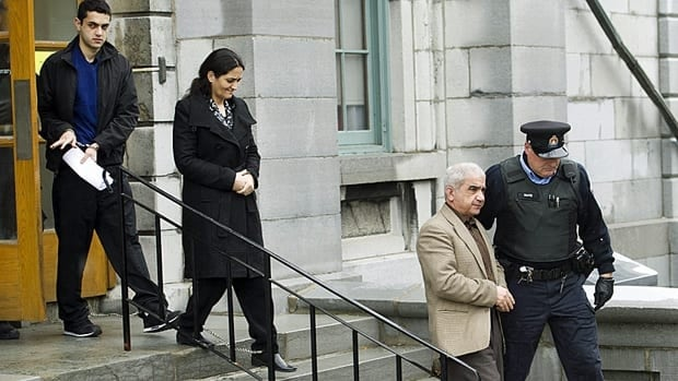 Mohammad Shafia, second right, Tooba Yahya, centre, and their son Hamed Shafia, left, are escorted during a lunch break at the Frontenac County courthouse in Kingston, Ontario on Jan. 27, 2012.