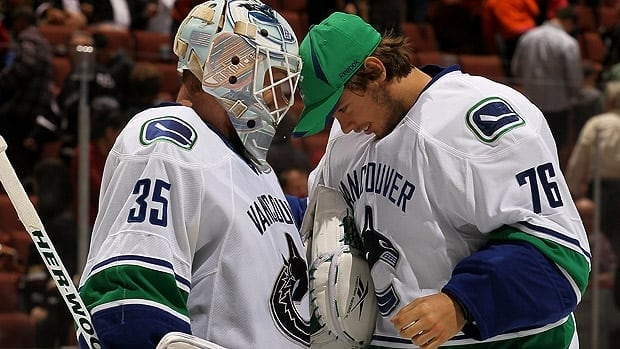 Will Vancouver's tandem next season be Cory Schneider, left, and Eddie Lack? Schneider and an NHL veteran? Neither? It all shapes up to be a fascinating offseason for the Canucks.