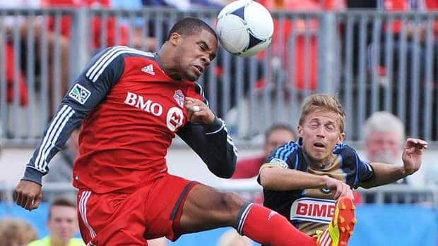 Toronto FC's Ryan Johnson, left, scored seven goals in 31 games this season.