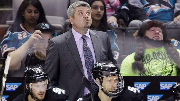San Jose Sharks head coach Todd McLellan, top, will be back behind the bench next season.