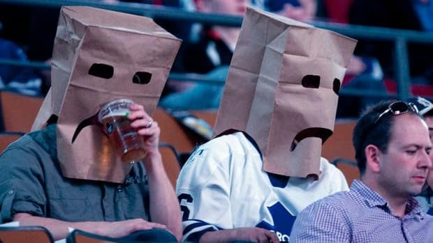 In this March 2012 photo, Maple Leafs fans wear paper bags before a game against the New York Islanders at the Air Canada Centre in Toronto.