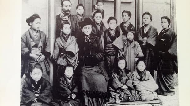Hamilton missionary Martha Cartmell and her students in front of Toyo Eiwa school in Tokyo in 1885.