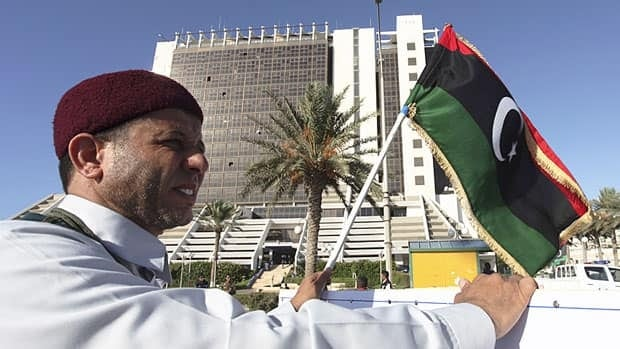 A Libyan participates in a protest against Ansar al-Shariah, a militia of Islamic extremists, and other Islamic militias in Benghazi, Libya on Friday.