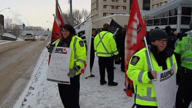 Prison guards, social workers and peace officers held a rally asking for their job categories to be included under new provincial legislation that makes it easier for first responders like police, firefighters and paramedics to get WCB coverage for post-traumatic stress disorder.