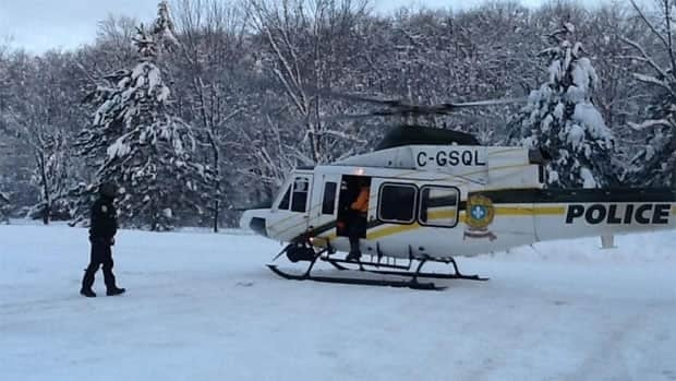 A helicoptor was needed to bring one of the snowshoers out of the woods.