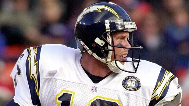 San Diego Chargers quarterback Ryan Leaf rolls out of the pocket as he looks for a receiver in the first quarter of an NFL football game against the Denver Broncos in Denver.