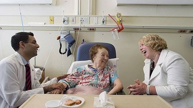 Ontario's health minister Deb Matthews visits with a patient at Toronto's Mount Sinai Hospital last week. The Health Council of Canada released a new report card says provinces are generally meeting commitments to boost home care and increase the number of doctors and nurses.