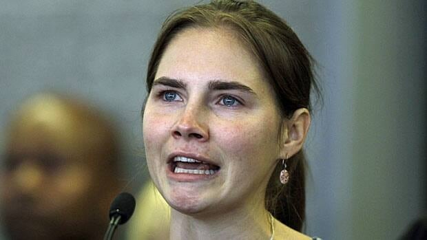 Amanda Knox looks up as she talks to reporters in Seattle Tuesday after flying home from Italy. She was was freed Monday after an Italian appeals court threw out her murder conviction for the death of her British roommate, Meredith Kercher.