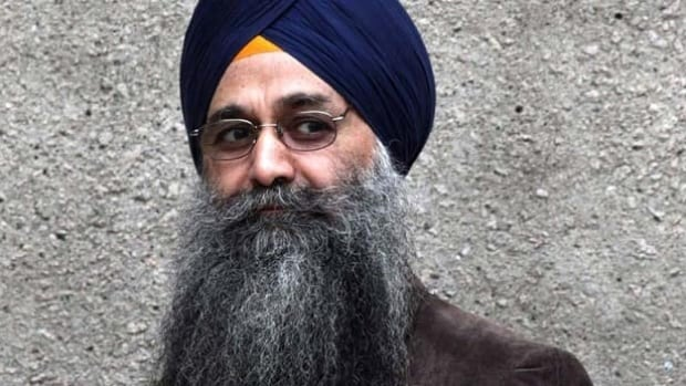 Inderjit Singh Reyat walks outside B.C. Supreme Court in Vancouver, B.C., in this September 10, 2010 photo.