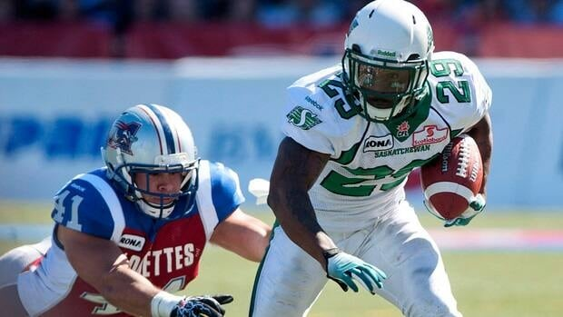 Montreal Alouettes' Shea Emry dives to tackle Saskatchewan Roughriders' Jock Sanders during in a game between the two teams on Sept. 16.