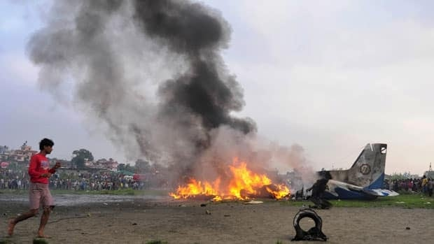 Witnesses reported that the plane, which crashed near the airport in the Nepali capital of Kathmandu, was on fire before it hit the ground.