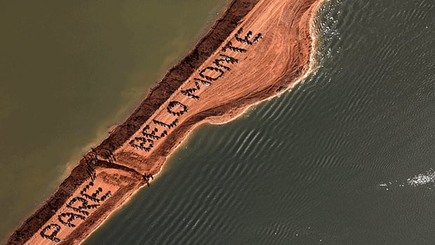 "Small farmers, native people and local residents occupy a section of the Belo Monte Dam project and  spell out the words that read in Portuguese; ""Stop Belo Monte,"" at the Xingu river in the Amazon."