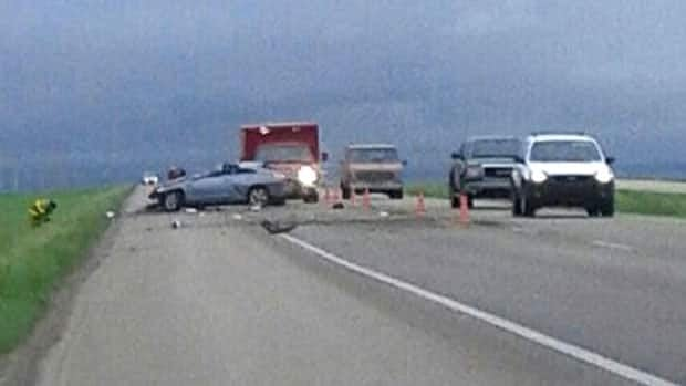Emergency crews at the scene of the single-vehicle rollover on Highway 1 near Caronport, Sask., on Saturday morning.