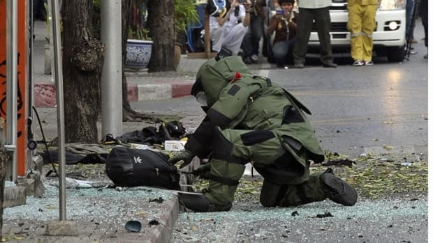 Three explosions went off in Bangkok Tuesday, wounding four people a day after assailants targeted Israeli diplomats in India and Georgia. Thai police blamed the attacks on a suspected bomber of Iranian descent, and are interrogating a second Iranian.