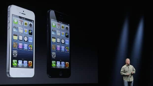 Apple's Phil Schiller announces the new iPhone 5 in San Francisco, California. The phone is bigger yet lighter than previous versions.