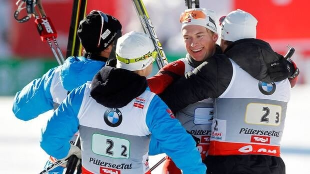 Norway athletes celebrate after winning the men's relay event at the IBU biathlon World Cup on December 9, 2012 in Hochfilzen, Austria.