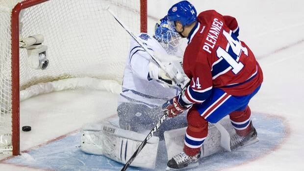 Montreal Canadiens forward Tomas Plekanec, right, puts one past Toronto Maple Leafs goaltender Ben Scrivens during the first period on Saturday.