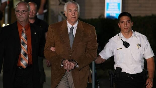 Former Penn State assistance coach Jerry Sandusky, centre, was convicted in June of 45 counts of sexual abuse involving 10 boys.