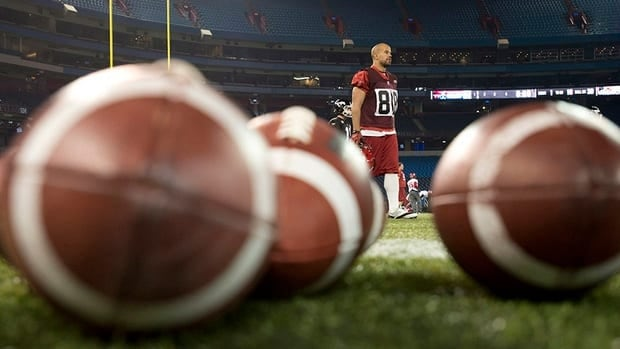 Calgary Stampeders running back Jon Cornish walks past practice balls during a practice Thursday, November 22, 2012 in Toronto. The Stampeders will face the Toronto Argonauts in the 100th CFL Grey Cup Sunday.