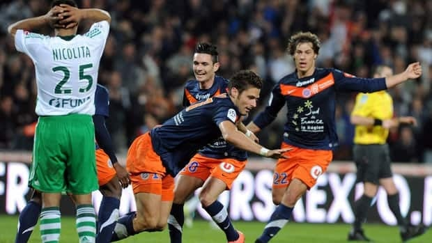 Montpellier's Olivier Giroud, centre,  reacts after scoring the game-winning goal against Saint-Etienne