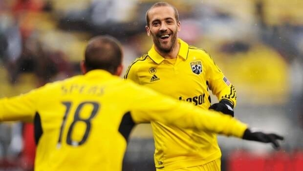 Federico Higuain (33) of the Columbus Crew celebrates his first half goal against Toronto FC with teammate Ben Speas (18) on October 28, 2012 in Columbus, Ohio.