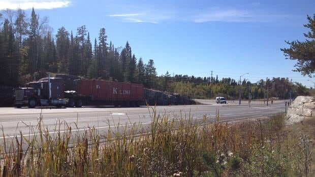 A section of Highway 17A north of Kenora, Ont., was closed to traffic following a collision Sunday morning involving a tractor-trailer and an OPP cruiser.