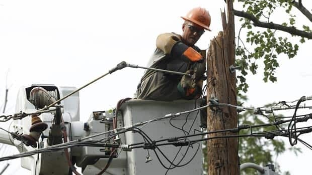 A Pepco contract worker tends to a damaged utility pole in Silver Spring, Md., on Tuesday.
