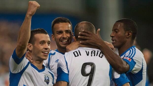 Montreal Impact's Felipe Martins, left to right, Dennis Iapichino, Marco Di Vaio and Patrice Bernier celebrate after Di Vaio scored against the San Jose Earthquakes during a match in August.
