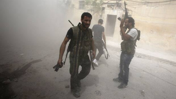 Free Syrian Army fighters are seen with their weapons during fighting with Syrian government forces in the El Amreeyeh neighbourhood of Syria's northwest city of Aleppo on August 30.