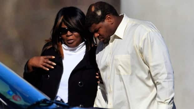 Dallas Cowboys football player Josh Brent, right, arrives at a memorial service for teammate Jerry Brown at Oak Cliff Bible Fellowship education centre on Tuesday.