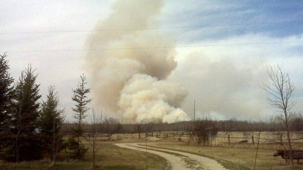 Smoke from a brush fire outside of Teulon, Manitoba, area can be seen from a considerable distance away.