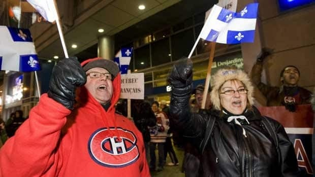 Pro-French language demonstrators rally outside the Bell Centre in Montreal on Saturday to protest the recent appointment of unilingual anglophone Randy Cunneyworth as head coach of the Montreal Canadiens.