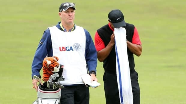 Tiger Woods waits with his caddie Joe Lacava on the second hole during the final round of the 112th U.S. Open at The Olympic Club on Sunday in San Francisco.