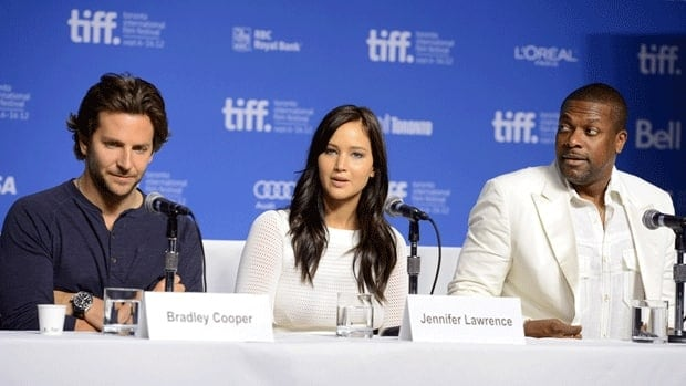 Silver Linings Playbook stars, from left, Bradley Cooper, Jennifer Lawrence and Chris Tucker, shown at a press conference during the 2012 Toronto International Film Festival on Sunday.