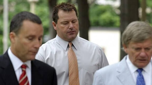 Former Major League baseball pitcher Roger Clemens, center, and his legal team, arrive at federal court in Washington.