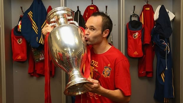 Andres Iniesta poses in the dressing room with the trophy following the final match between Spain and Italy at the Olympic Stadium on July 1, 2012 in Kiev, Ukraine.