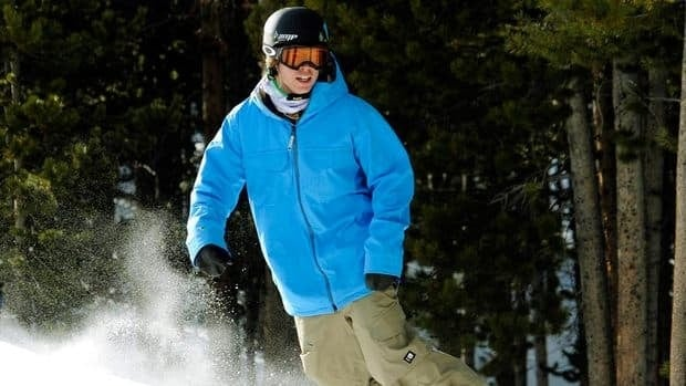 American snowboarder Kevin Pearce hits the slopes on Dec. 13, 2011. He suffered a traumatic brain injury during a halfpipe training run in 2009.