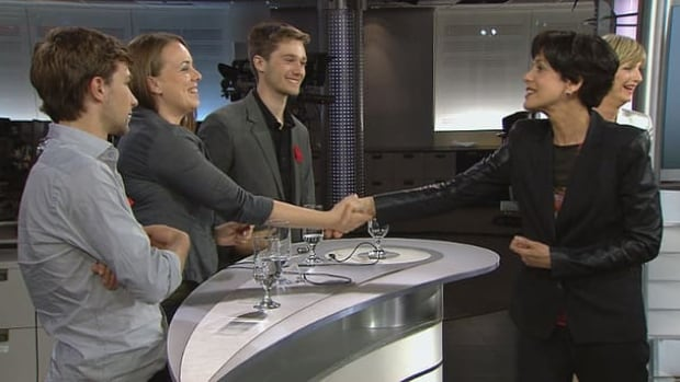 Student leaders shake hands with Education Minister Michelle Courchesne Friday during an appearance on Radio-Canada.