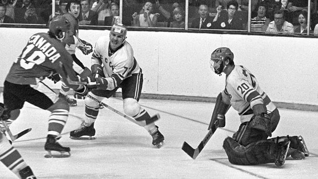 Team Canada's Paul Henderson (left) shoots on Team USSR's Vladislav Tretiak while Gannady Tsygankov defends during the 1972 Summit tournament in Toronto on Sept. 4, 1972.
