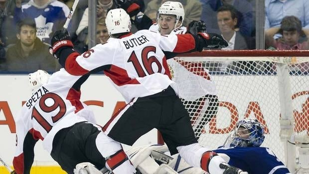 Ottawa Senators centre Jason Spezza, left, celebrates his goal on Toronto Maple Leafs goaltender James Reimer, right, with teammates Bobby Butler, centre,  and Kaspars Daugavins on Tuesday night.