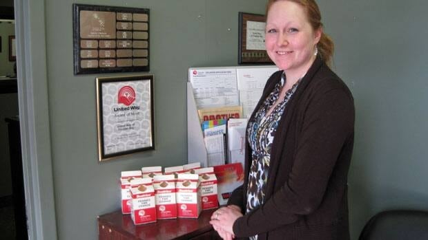 Kristy Hilliard, communications director with the United Way of Thunder Bay, shows off the collection cartons for the Pennies for Change campaign.