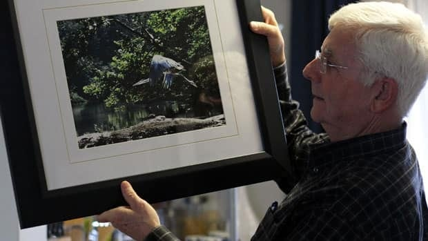 Sudbury resident Dan Racicot looks at a piece of his artwork. Having creative outlets like photography, art and music, have helped Racicot in his recovery from sexual abuse. He was abused by a female family member when he was a youngster.