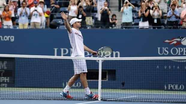 Andy Roddick waves to fans after his fourth round loss to Argentina's Juan Martin Del Potro at the 2012 US Open on Wednesday, Sept. 5, 2012, in New York. Roddick said he would retire after the match.