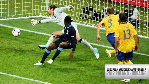 England forward Daniel Welbeck, front left, scores a beautiful back-heel goal past Sweden goalkeeper Andreas Isaksson Friday in Kiev, Ukraine.