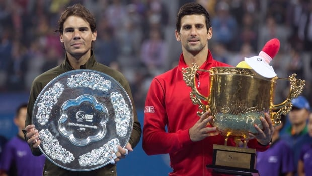 Novak Djokovic of Serbia, right, and Rafael Nadal of Spain pose with their trophies after the China Open final at the National Tennis Stadium in Beijing on Sunday.
