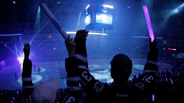 Winnipeg Jets fans cheer at a home game against the Los Angeles Kings at the MTS Centre on Oct. 4, 2013.