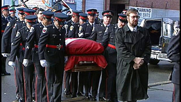 The 1993 funeral for Sudbury police officer Joe MacDonald was attended by hundreds of people in the city's downtown.