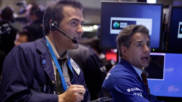 Traders on the New York Stock Exchange, above, and other stock markets around the world were becoming increasingly nervous about the potential fallout from the U.S. government shutdown, which entered its second week Monday.