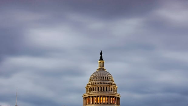 The Capitol in Washington is seen under an overcast sky early Monday.  The U.S. government shutdown entered its second week with no end in sight and ominous signs that the United States was closer to the first default in its history.